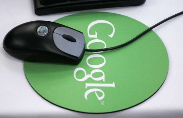 A mouse sits atop a Google mousepad at