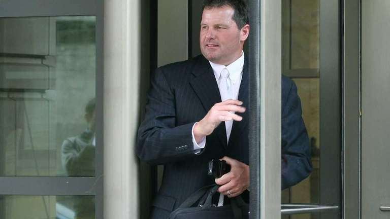 Roger Clemens leaves the U.S. District Court after