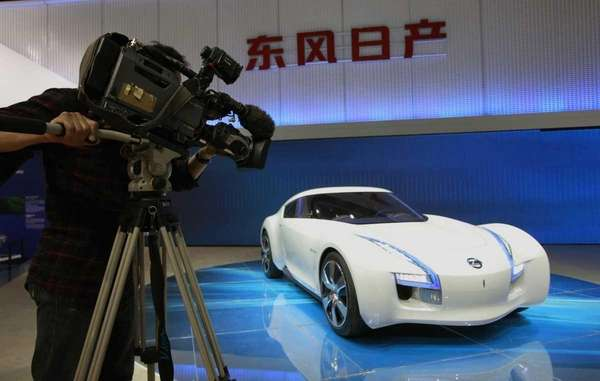 A cameraman films Nissan's latest concept and electronic