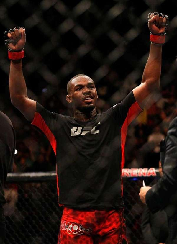 Jon Jones celebrates defeating Rashad Evans by unanimous