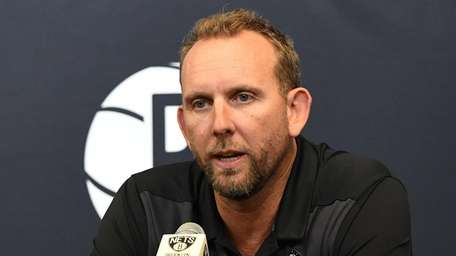 Nets general manager Sean Marks speaks to the