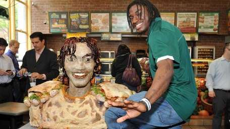 Robert Griffin III poses with his life-size statue