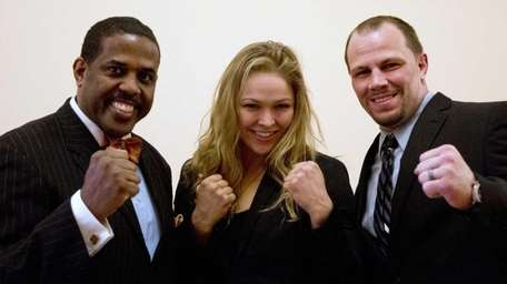 Sen. Kevin Parker, D-Brooklyn, left, poses with MMA