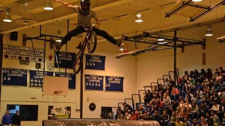 BMX rider Jimmy Walker, of Chicago, performs a