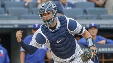 Yankees catcher Gary Sanchez reacts after tagging out