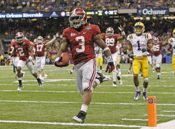 Alabama's Trent Richardson (3) scores a touchdown during