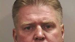 A longtime Nassau cop was arrested Tuesday on