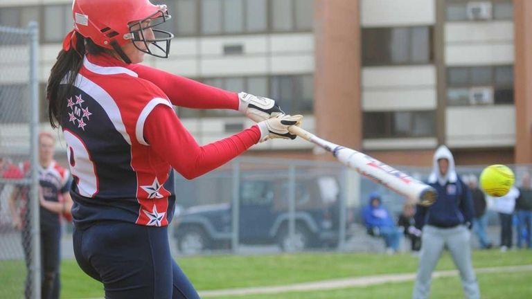 MacArthur High School shortstop Jena Cozza pulls a