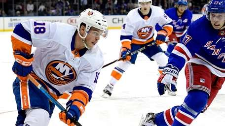 Anthony Beauvillier #18 of the Islanders carries the