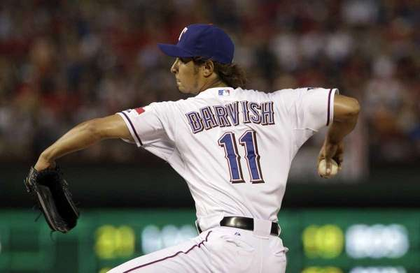 Texas Rangers' Yu Darvish, of Japan, delivers to