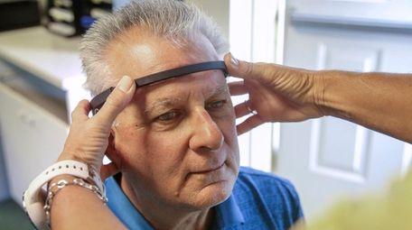 Ron Mirro has a brain sensor placed on