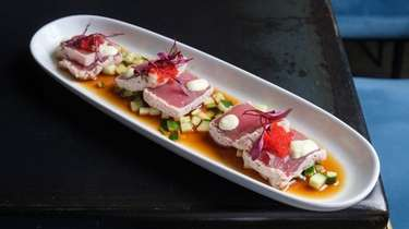 The tuna tataki floats on a cucumber-enhanced soy