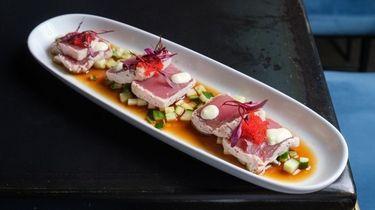 The tuna tataki floats on a cucumber-enhanced soy