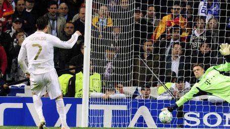 Bayern Munich's goalkeeper Manuel Neuer stops a penalty
