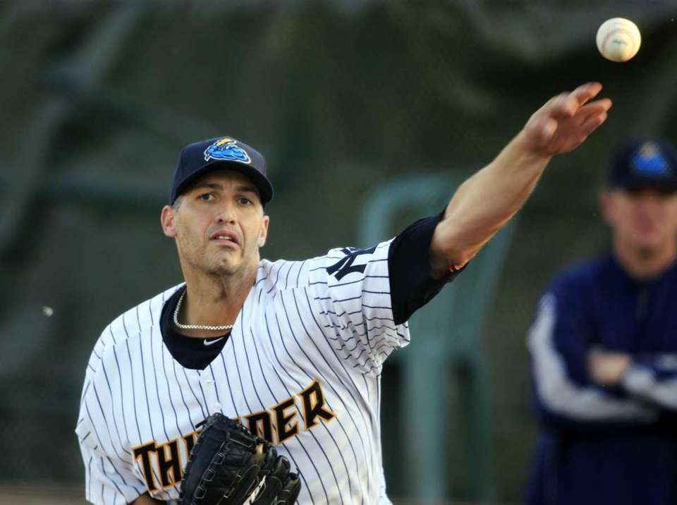 New York Yankees pitcher Andy Pettitte warms up