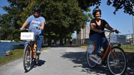 Christina and Robert Santos of Babylon ride bike-share