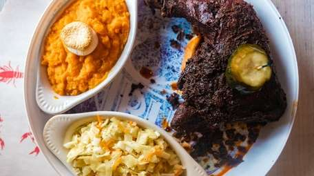 Nashville hot chicken is served with cole slaw