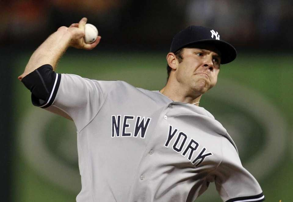 New York Yankees' David Phelps delivers to the