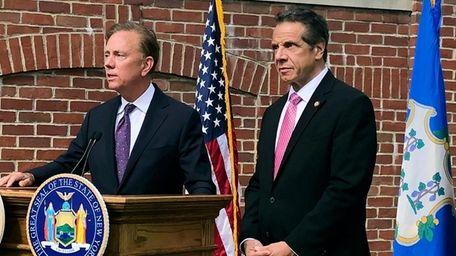 Connecticut Gov. Ned Lamont, left, speaks as New