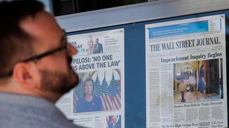 A visitor at the Newseum in Washington looks