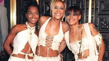 The band TLC, from left, Rozanda