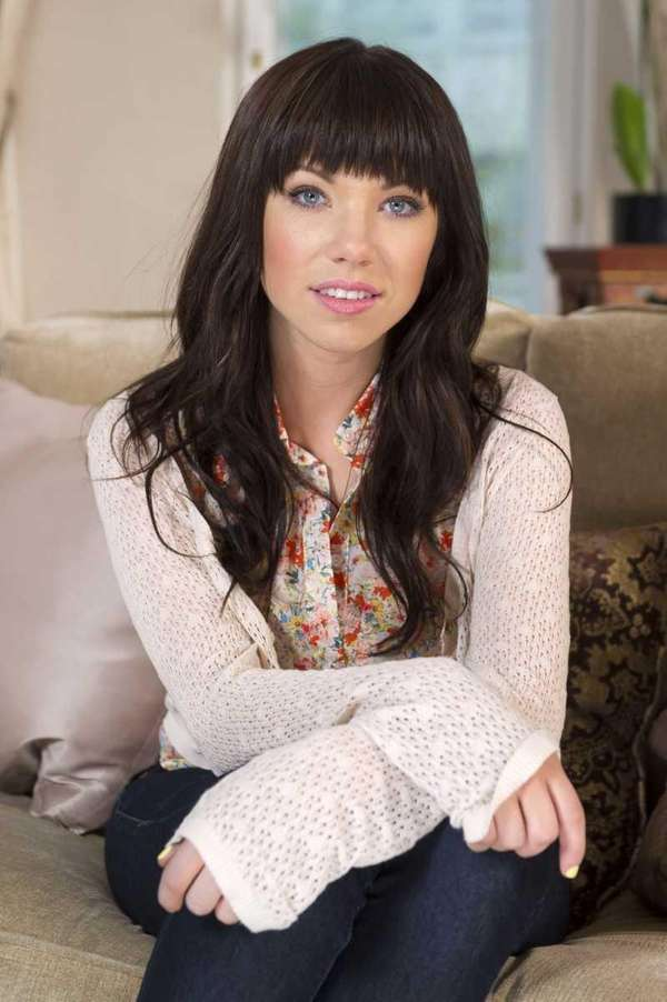 Canadian singer Carly Rae Jepsen poses for photographs
