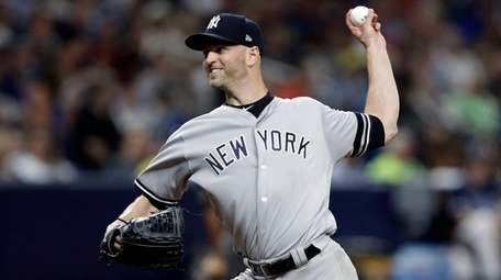 Yankees pitcher J.A. Happ delivers to a Tampa