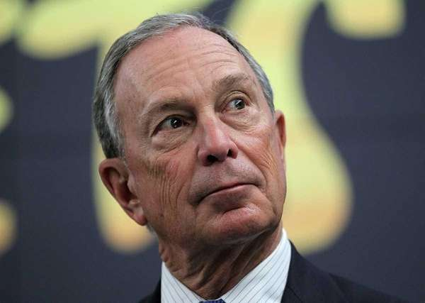 New York City Mayor Michael Bloomberg looks on