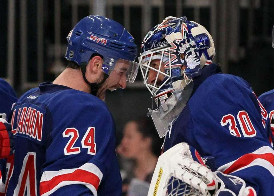Henrik Lundqvist #30 and Ryan Callahan #24 of