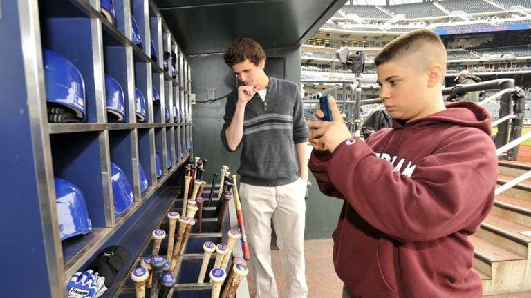 Anthony Vanaria, right, uses his cell phone camera