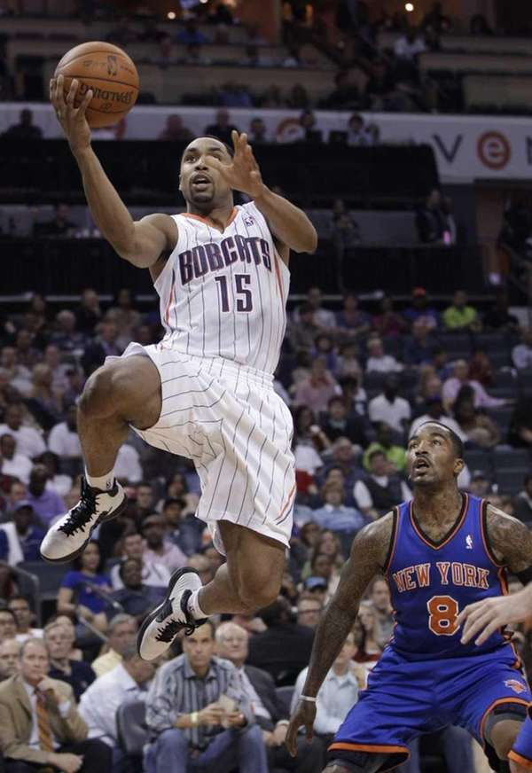 Charlotte Bobcats' Gerald Henderson (15) drives past New