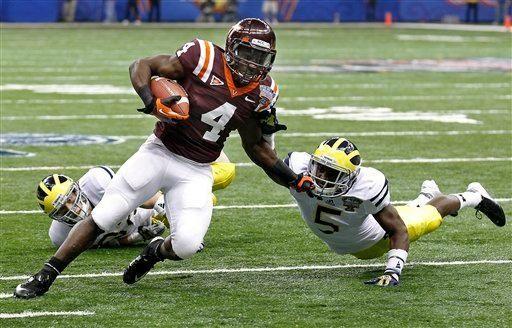 Virginia Tech running back David Wilson (4) carries