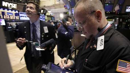 Robert Arciero, right, works with fellow traders on