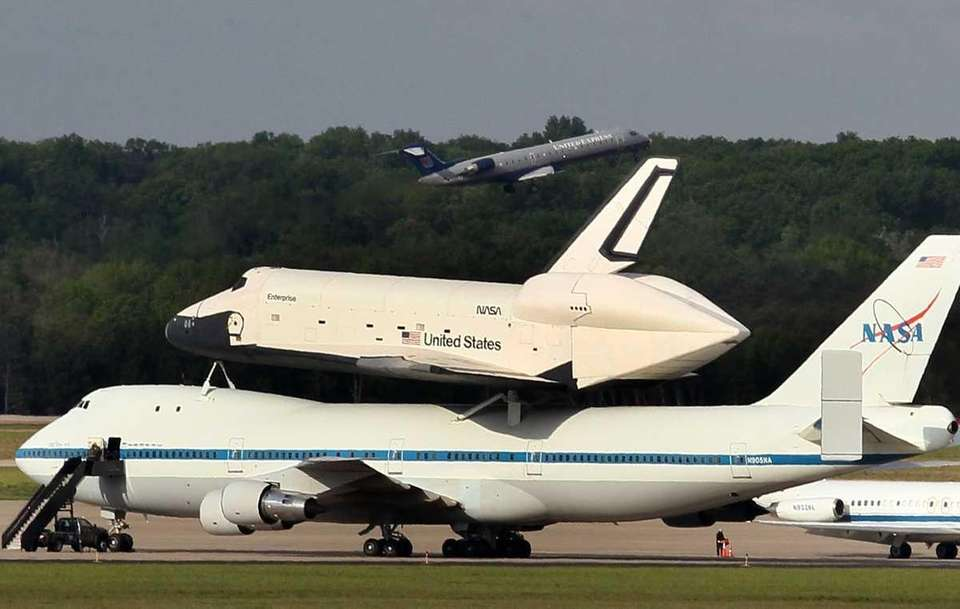 The Space Shuttle Enterprise sits atop a NASA