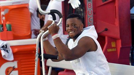 Giants running back Saquon Barkley smiles as he