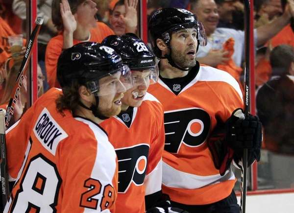 From left, Philadelphia Flyers' Claude Giroux, Erik Gustafsson