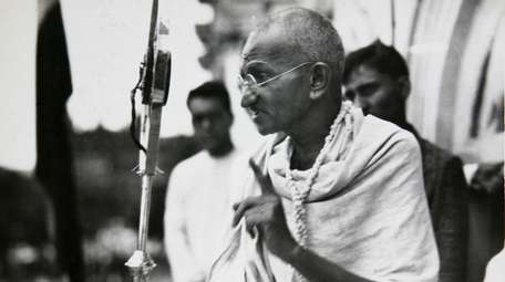Mahatma Gandhi talks to a crowd in India