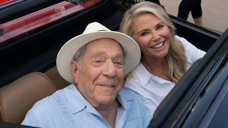 George Segal and Christie Brinkley appear in a