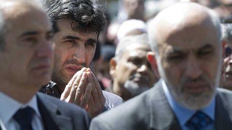 People observe the funeral of Muslim leader Ghazi