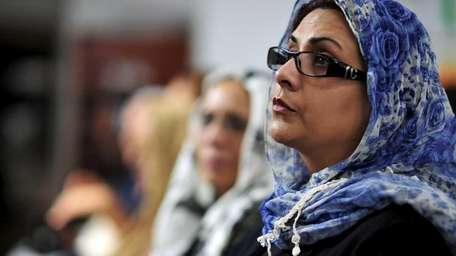 Nazli Chaudhry of Commack listens to Dr. Azizah