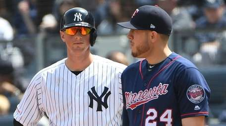 The Yankees' DJ LeMahieu stands on first base