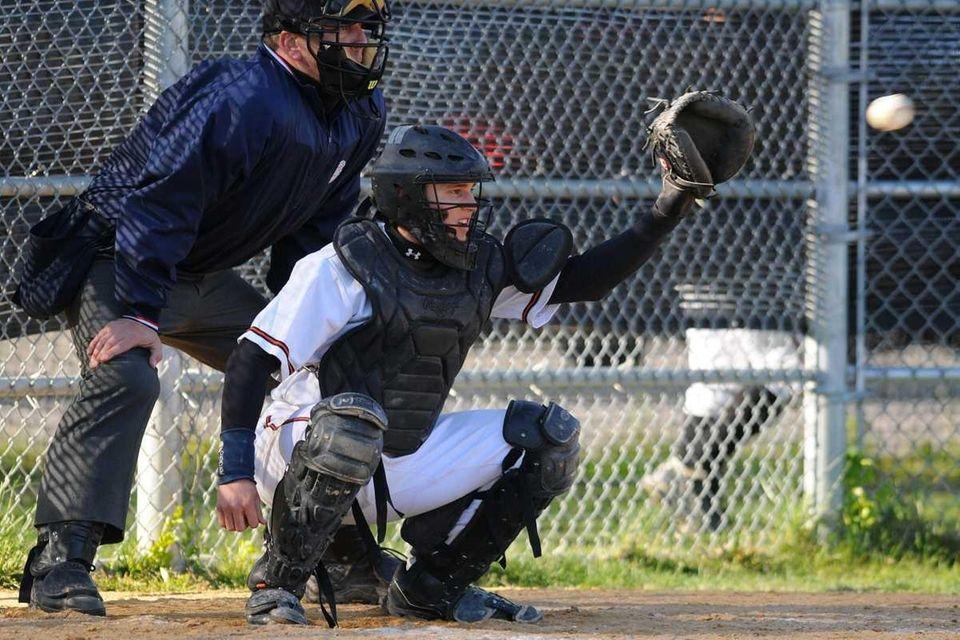Babylon High School catcher #8 Bryan Dromerhauser tries