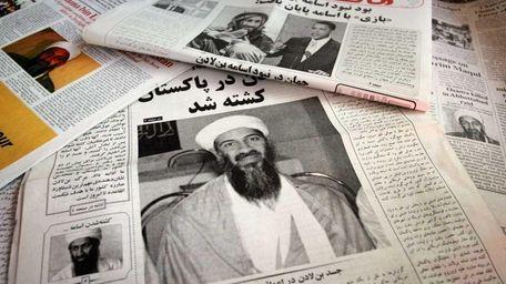 Newspapers in Kabul, Afghanistan, headline the killing of