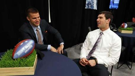 Stanford quarterback Andrew Luck, right, waits with Stanford's