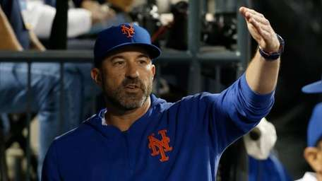 Manager Mickey Callaway #36 of the Mets looks