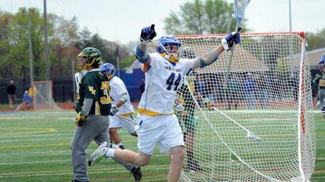West Islip's #44 Tom Moore celebrates a goal