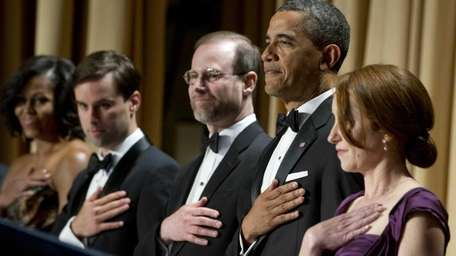 President Barack Obama, second from right, stands alongside