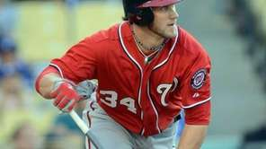 Bryce Harper #34 of the Washington Nationals watches