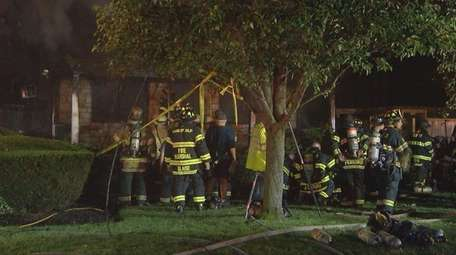 Firefighters from at least six Suffolk County departments