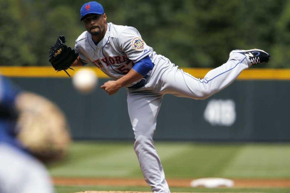 New York Mets starting pitcher Johan Santana watches